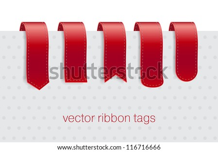 A collection of red ribbon tags