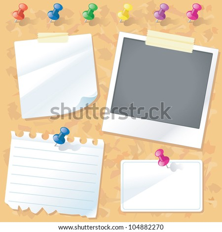 A cork notice board with a set of colorful pushpins papers a polaroid photo a business card and masking tape.