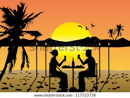 a couple dining on the beach at sunset
