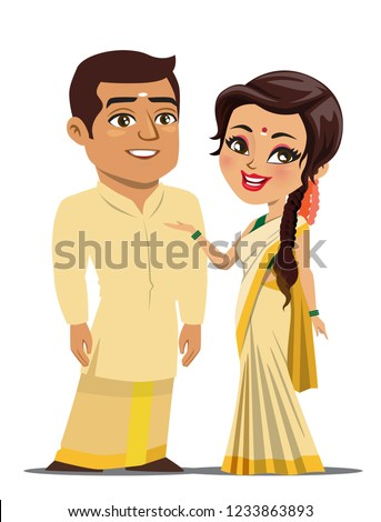 A couple from the south Indian state of Kerala, India are wearing traditional festival outfits (mundu/ dhoti) and standing together.