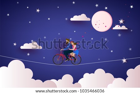 a couple riding bicycle to the