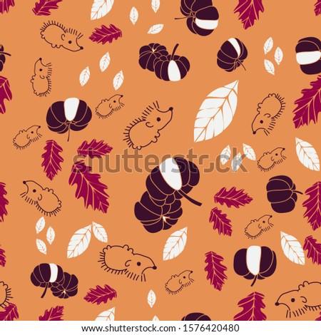 a cute hedgedog with pumpkins