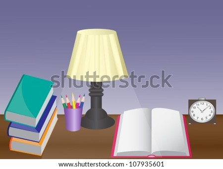 a desk with a lamp, books, alarm clock and pencils