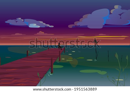 a fisherman sits in the night