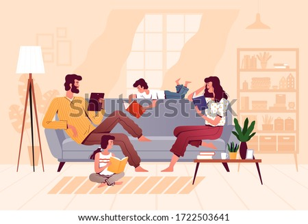 A friendly family reads books together in the living room at home. Parents and children are sitting on the couch. The concept of joint family reading