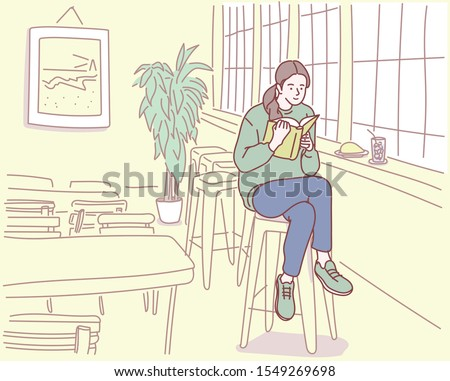 A girl is sitting in a cafe and reading a book. Inside the cafe. hand drawn style vector design illustrations.