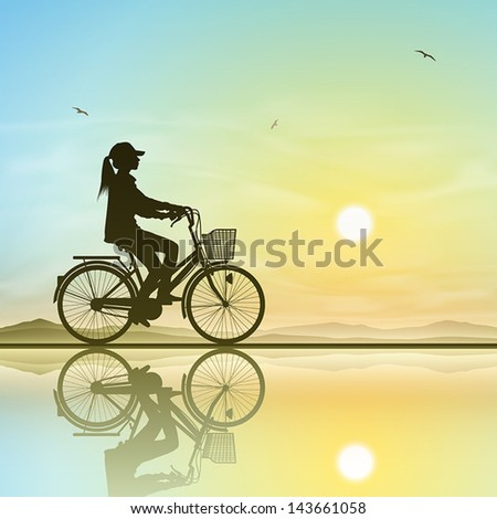 a girl on a bicycle in