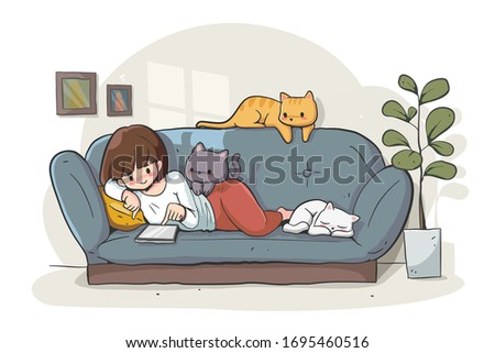 a girl relaxing with three cats