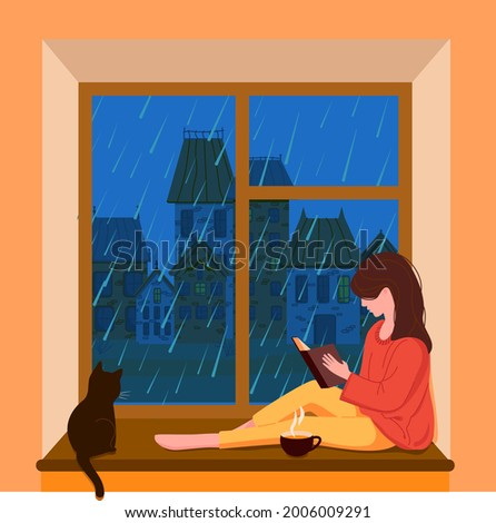 A girl sits at the window, reads a book and drinks tea while it is raining outside the window. The city outside the window. Fall. The cat is at the window. Vector illustration