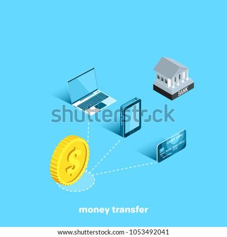 a gold coin next to a laptop