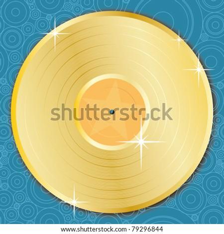 A gold vinyl record on a seamless background.