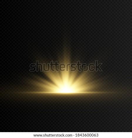A golden flash of light. Sunshine, dawn, sun. Light beams. Golden light. Light png. Christmas.