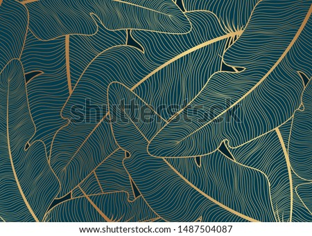 A green background with golden feathers. Stock photo ©