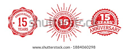 A group of 15 years anniversary logos drawn in the form of stamps, red frames for celebration. Grunge rubber stamp texture. Holiday stamps. Collection of postage stamps. Vector round stamps