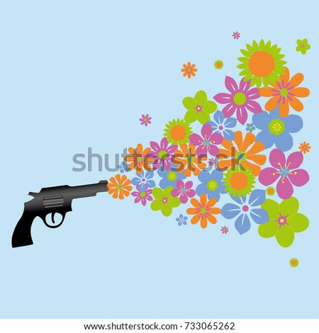 a gun shooting colorful flowers