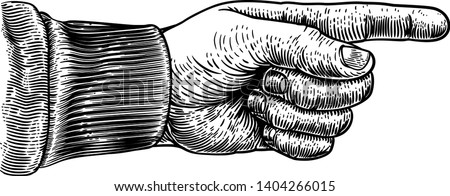 a hand pointing a finger in a