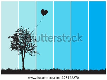 a heart balloon stuck in a tree
