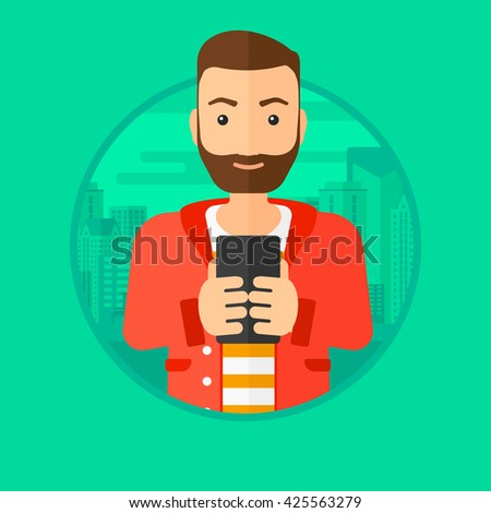 A hipster man with the beard using smartphone on a city background. Vector flat design illustration in the circle isolated on background.