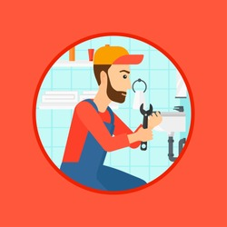 A hipster plumber sitting in a bathroom and repairing sink pipe. Plumber with wrench repairing a broken sink in bathroom. Vector flat design illustration in the circle isolated on background.