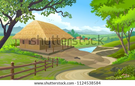 A house in a village with roof made of straws and walls made of clay.
