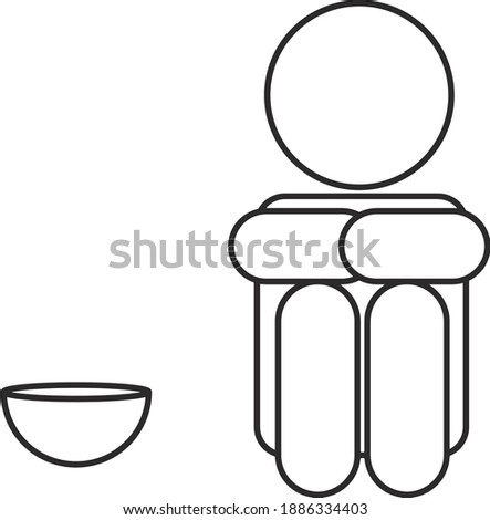 A hungry or starving person with a bowl next to him. Stock photo ©