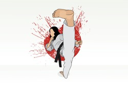 A karate girl in a kimono, practicing the martial art of karate, does a stretch.