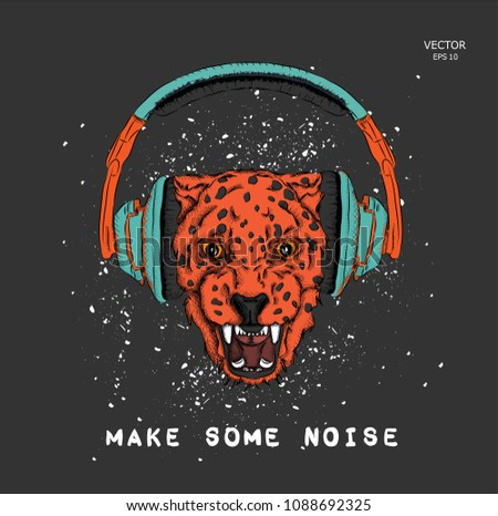a leopard in headphones on a