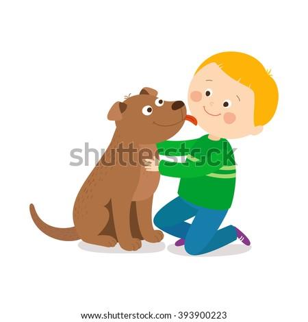 a little dog licking a boy's