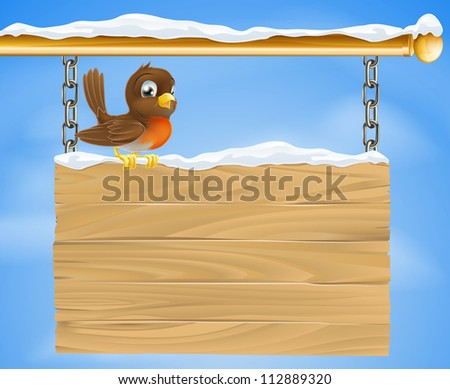 A loveable Christmas robin bird on wooden sign on a cold December winter day