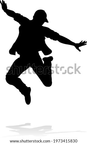 A male street dance hip hop dancer in silhouette Stock photo ©
