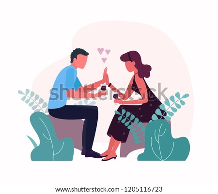 A man and a woman, lovers, hold hands and drink wine. Date or romance