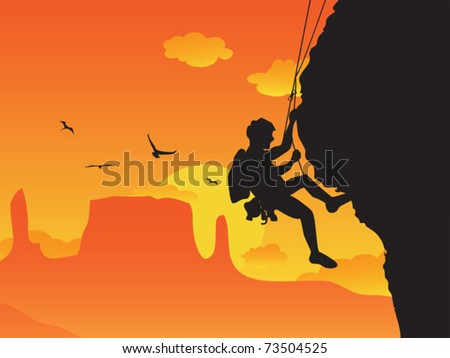 a man doing rock climbing