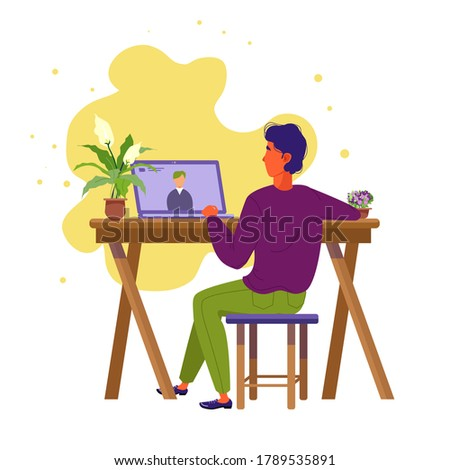 A man in an online interview. The guy is sitting at his laptop. Online communication. Interview during isolation. Remote work.