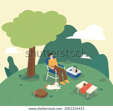 a man is camping while sitting