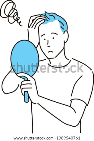 A man looking at the mirror worried about his hair getting thinner Stock photo ©