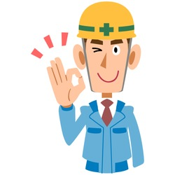 A man on the construction site in blue work wear shows an OK hand sign