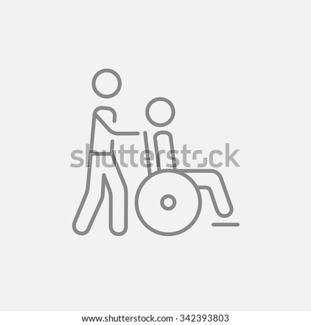 a man pushing a wheelchair with