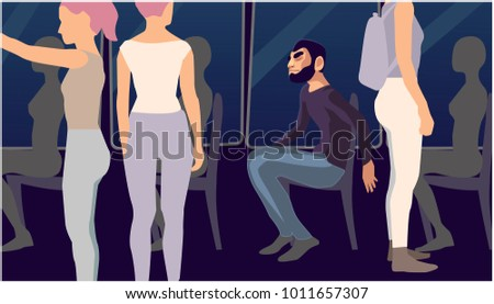 a man sits  around are women
