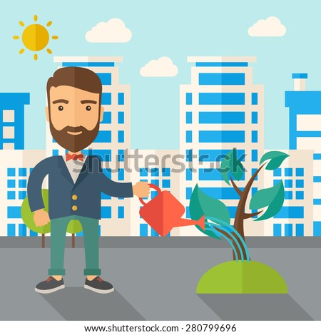 a man watering the growing