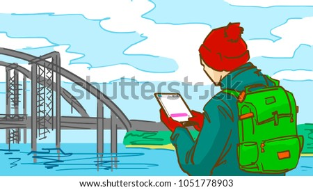 a man with a tablet is outdoor