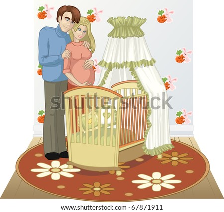 A married couple stands near the cradle