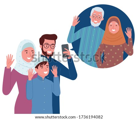 a Muslim family consisting of parents and their children is making a video call with their grandparents. Zdjęcia stock ©