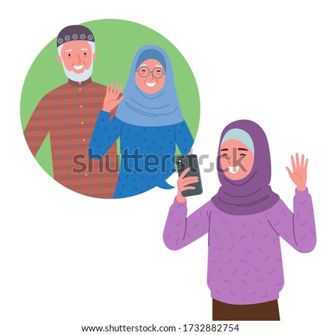 a Muslim girl wearing a hijab is doing a video call with her grandfather and grandmother via cell phone. Zdjęcia stock ©