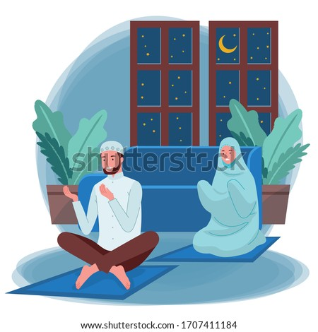 A pair of Muslim women and men are doing their Nightly prayer or Tarawih at night inside their homes. Laylat al-Qadr. Night of Decree. Night of Power.