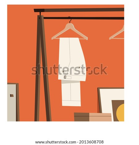 a pent hanging on hanger in wardrobe, colorful vector illustration, ready to print and editable file Foto stock ©
