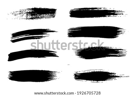 A ring of rough paint brushes black and white.  Mega set of vector brushes for artistic drawing.