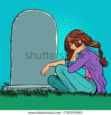 a sad widow or daughter near a