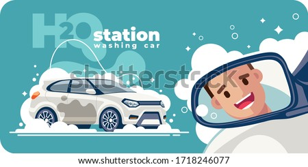 A satisfied and happy customer smiles in the rear view mirror of the vehicle, leaving in a clean white car from the car wash station. His transport was washed with water with foam.