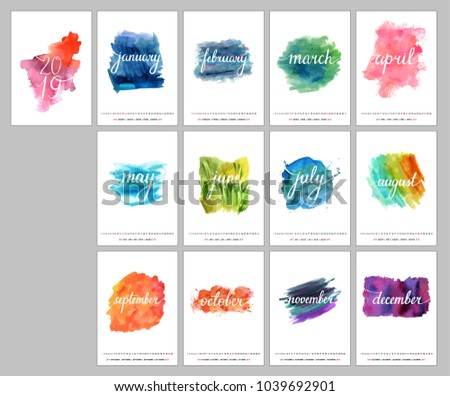 A scalable vector calendar for the year 2019. Each of the twelve months and the cover is presented on a corresponding bright watercolor texture. There is a place for text and logos