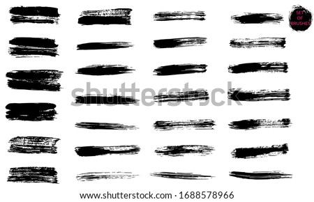 A set of brush strokes. A collection of vector black lines, for grunge design and decoration, isolated on a white background.